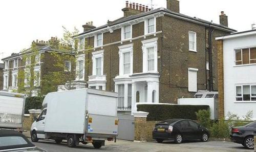 Removals London van in front of a house
