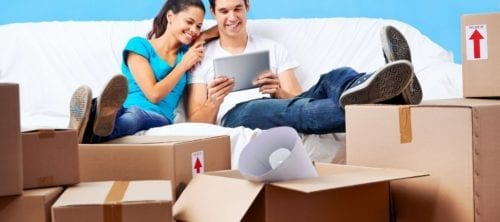 Young couple happy to compare removal quotes for their move to a new house