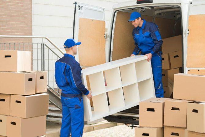 Moving company loading a shelf onto a removal van