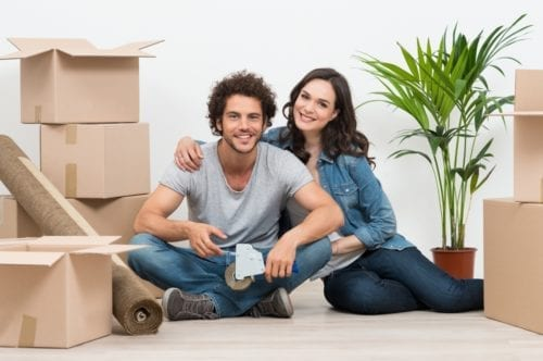 Couple smiling about their move to a new home