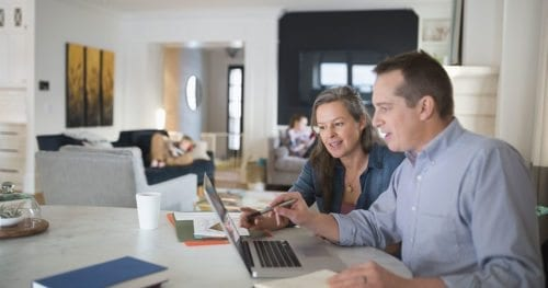 Parents conducting research online on moving