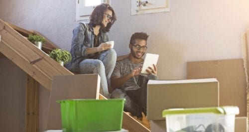 Young couple looking for online quotes for removals