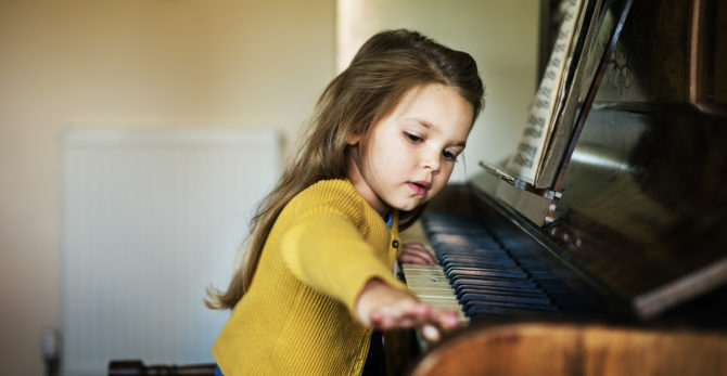 Girl playing the piano - piano removals